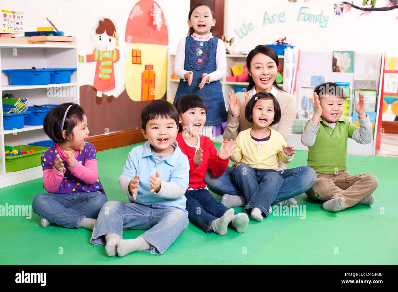Female teacher and cute kindergarten children clapping hands and stock photo 54458527 alamy - Children s day images download ...