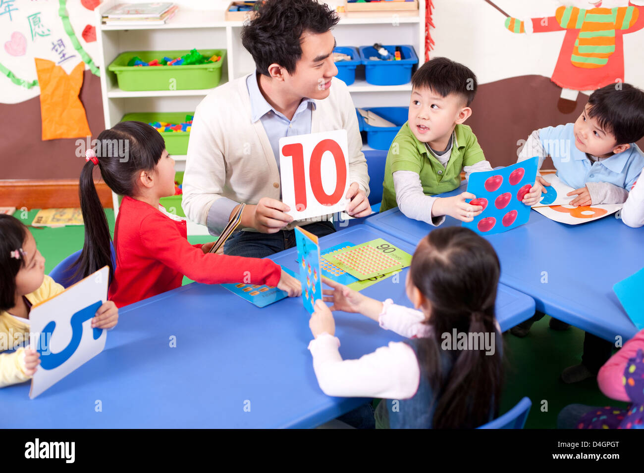 Kindergarten teacher teaching children maths Stock Photo: 54458680 ...