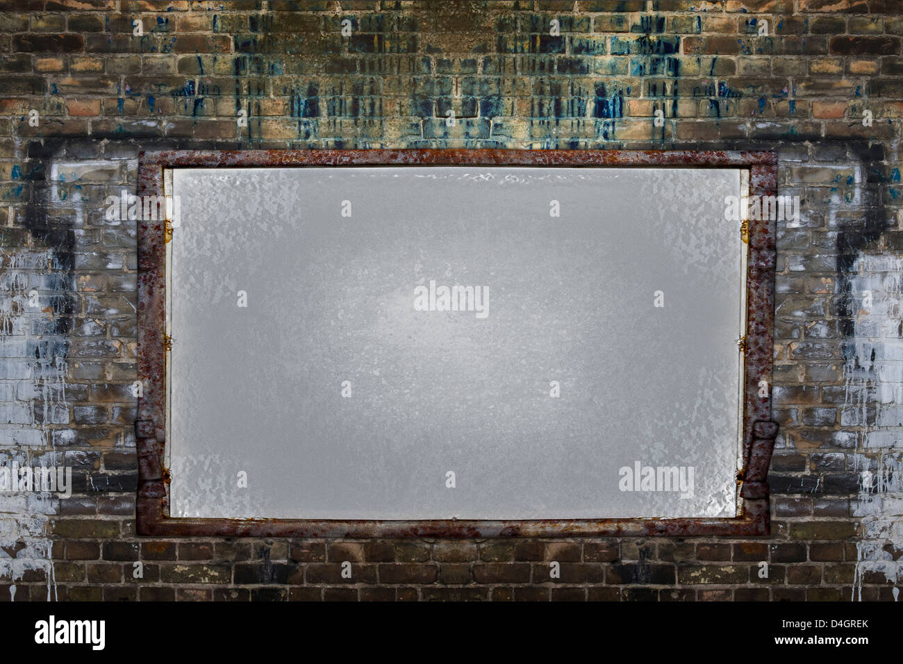 Filthy brick wall with empty framed board - Stock Image