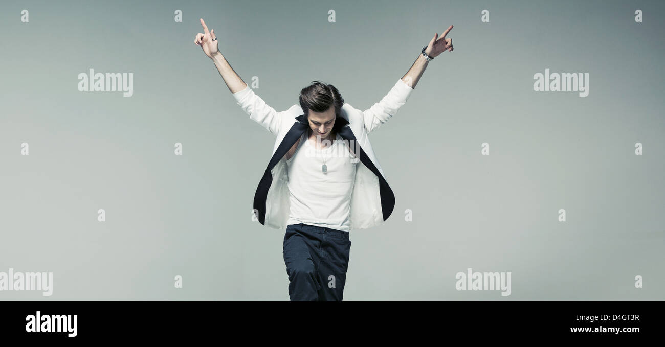 Handsome fashionable man in fantastic mood - Stock Image