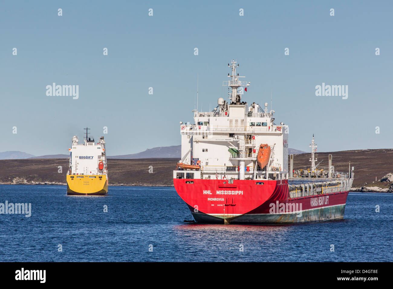 Commercial container ship in the port of Stanley, East Falkland Island, South Atlantic Ocean, South America - Stock Image