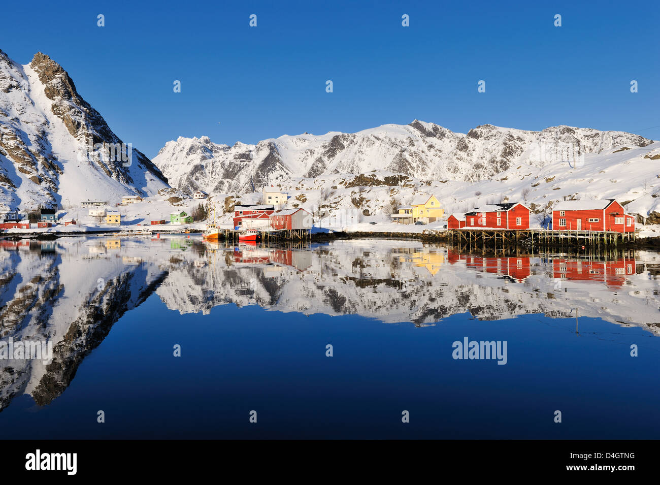 Remote fishing village reflected in water, Lofoten, Nordland, Norway, Europe - Stock Image