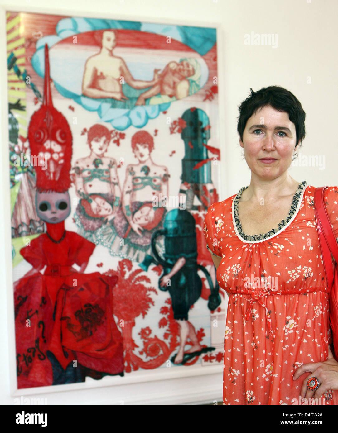 German artist Cornelia Renz stands in front of her painting 'Humorvolle Ausblicke auf eine Welt im Chaos' - Stock Image
