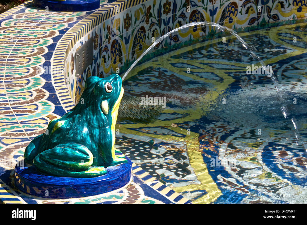 Ceramic frog spitting out water, Frogs Fountain, Maria Luisa Park, Seville, Andalusia, Spain - Stock Image
