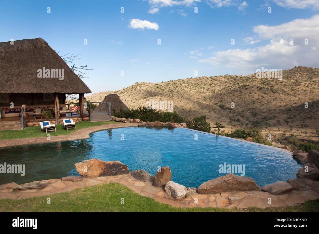 Infinity pool and view from Borana luxury safari lodge, Laikipia, Kenya, East Africa - Stock Image