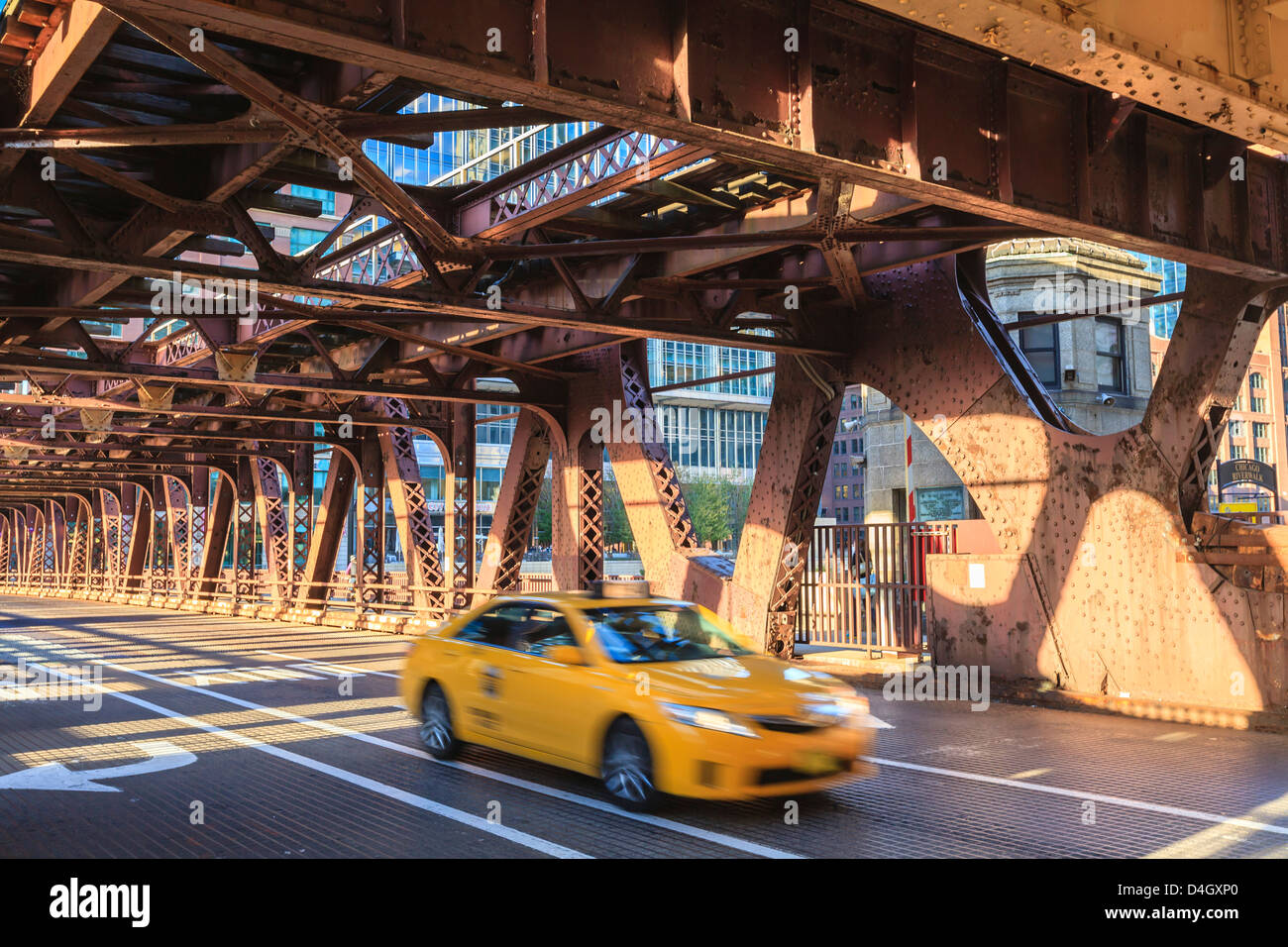 Yellow taxi crossing a bridge over the Chicago River, Chicago, Illinois, USA - Stock Image