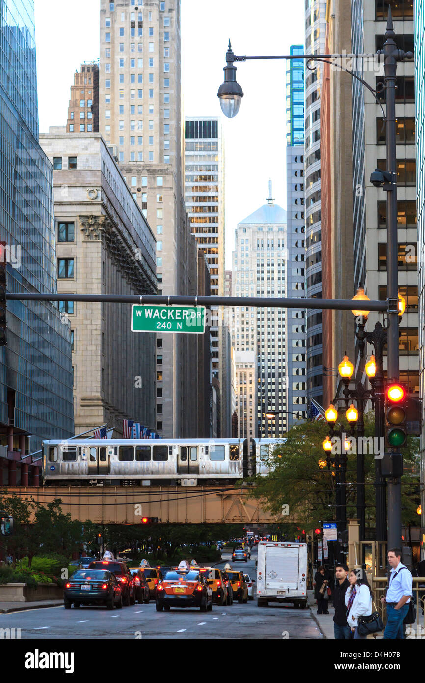 L train on elevated track crosses South LaSalle Street in the Loop district, Chicago, Illinois, USA - Stock Image
