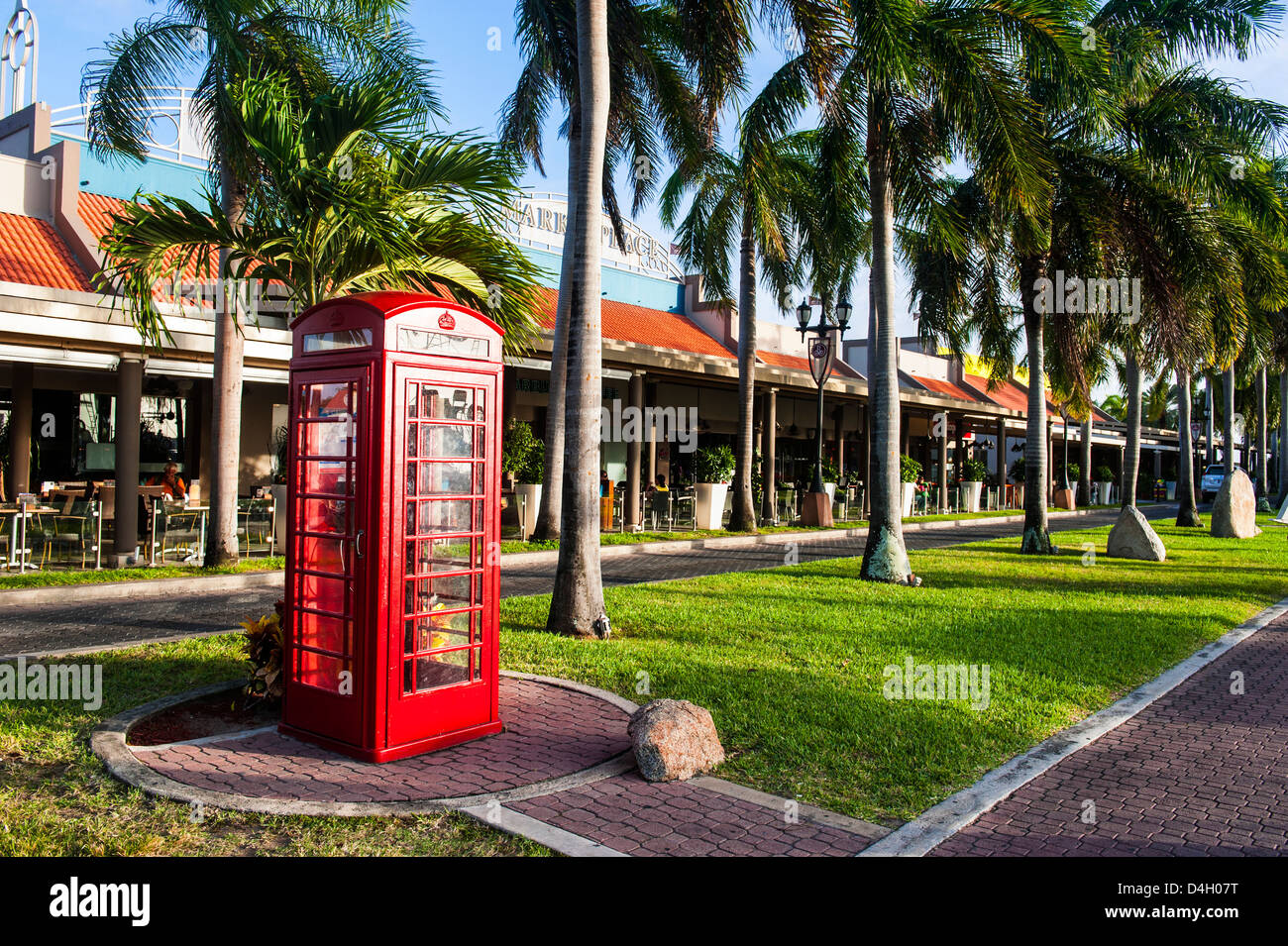 Red telephone box in downtown Oranjestad, capital of Aruba, ABC Islands, Netherlands Antilles, Caribbean - Stock Image