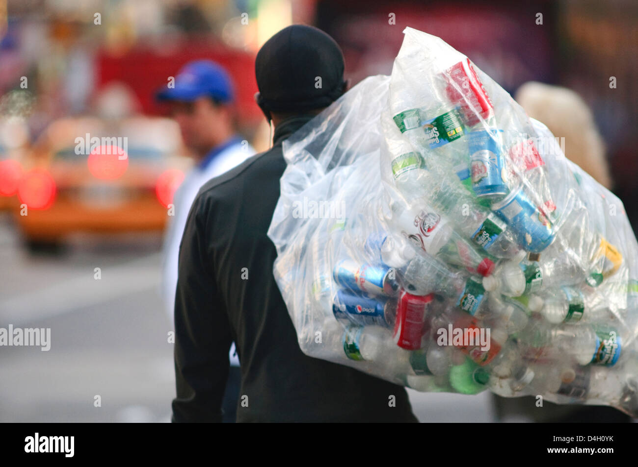 Usa, New York City, Manhattan, Recyclable Garbage Man Carrying - Stock Image