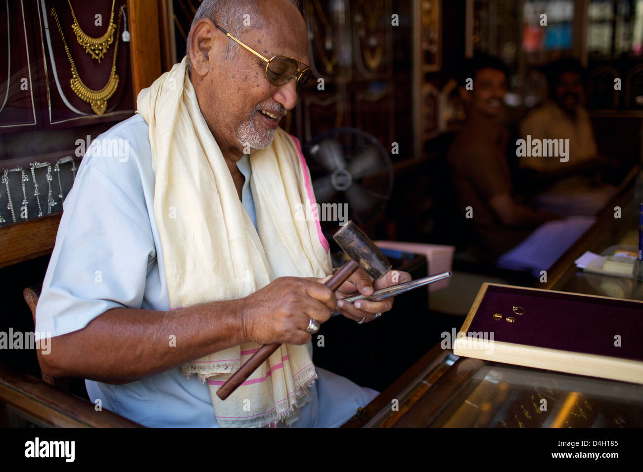 A gold jeweller in a small market in the city of Thuckalay in south Kerala, India - Stock Image