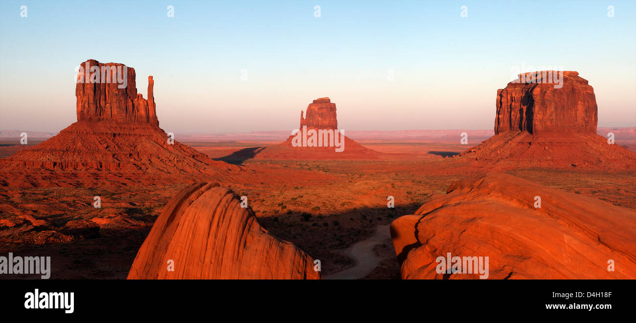 Panoramic photo of the Mittens at dusk, Monument Valley Navajo Tribal Park, Utah, USA - Stock Image