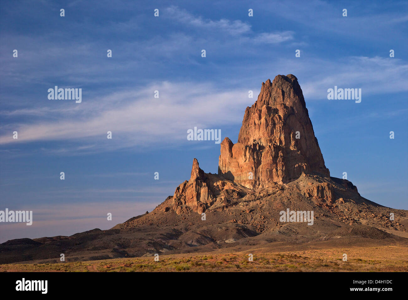 Morning sunlight on Agathia Peak (El Capita),  near Monument Valley, on Arizona Highway 163, Arizona, USA - Stock Image