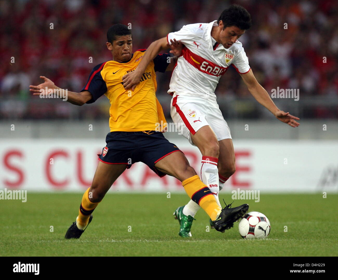 Stuttgart's Ciprian Marica (R) and Arsenal's Denilson (L) vie for the ball during the soccer test match - Stock Image