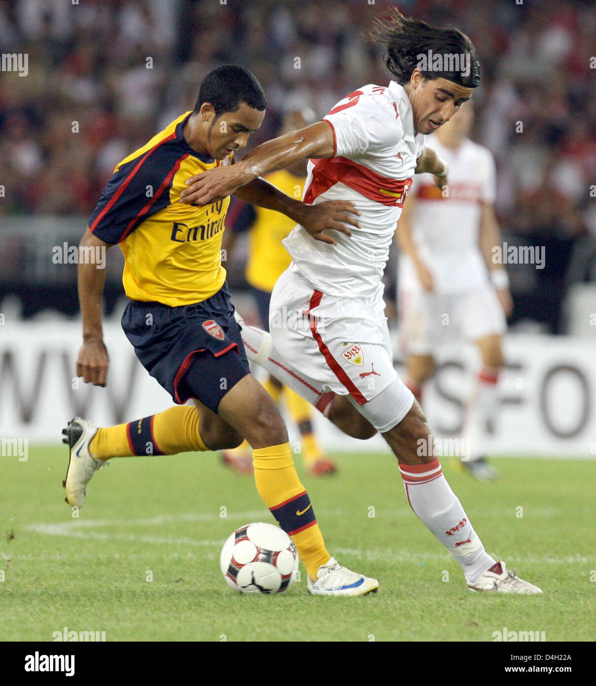 Stuttgart's Sami Khedira (R) and Theo Walcott (L) vie for the ball during the soccer test match between German - Stock Image