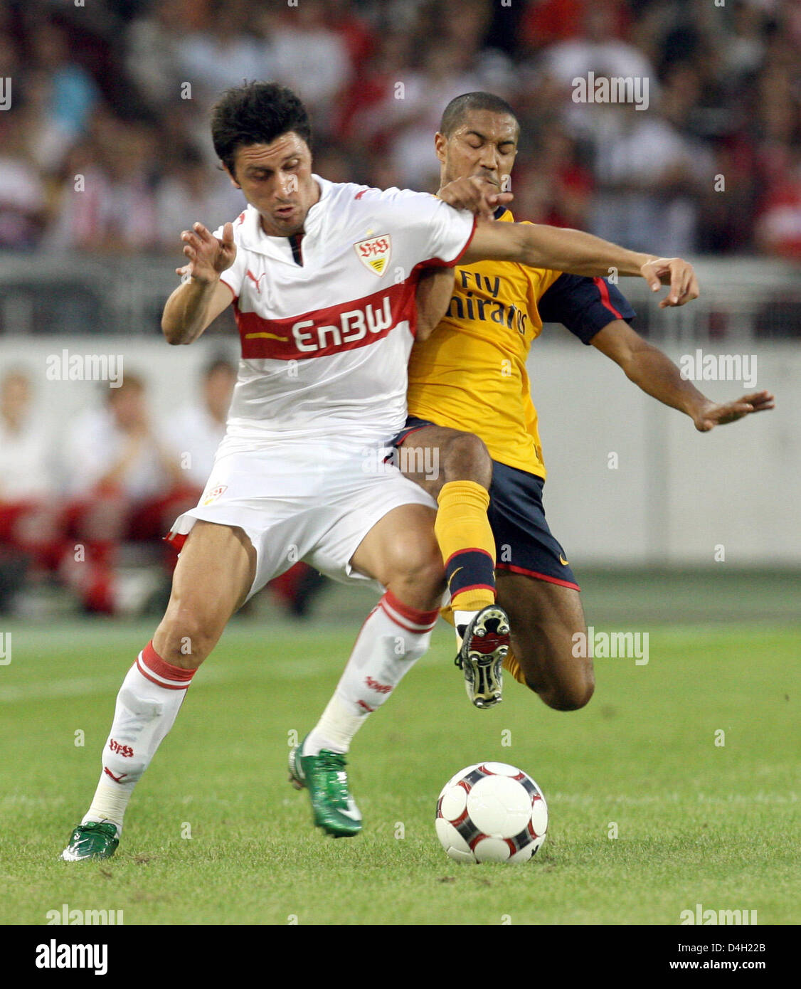 Stuttgart's Ciprian Marica (L) and Arsenal's Gael Clichy (R) vie for the ball during the soccer test match - Stock Image