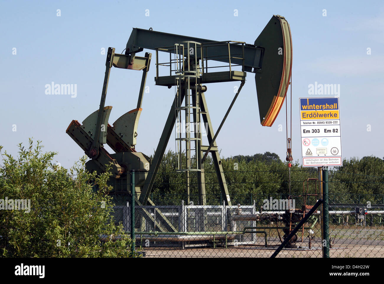 A 'Winterhall' sign post seen in front of a pumpjack-type oil pump near Emlichheim, County Bentheim, Germany, 28 Stock Photo