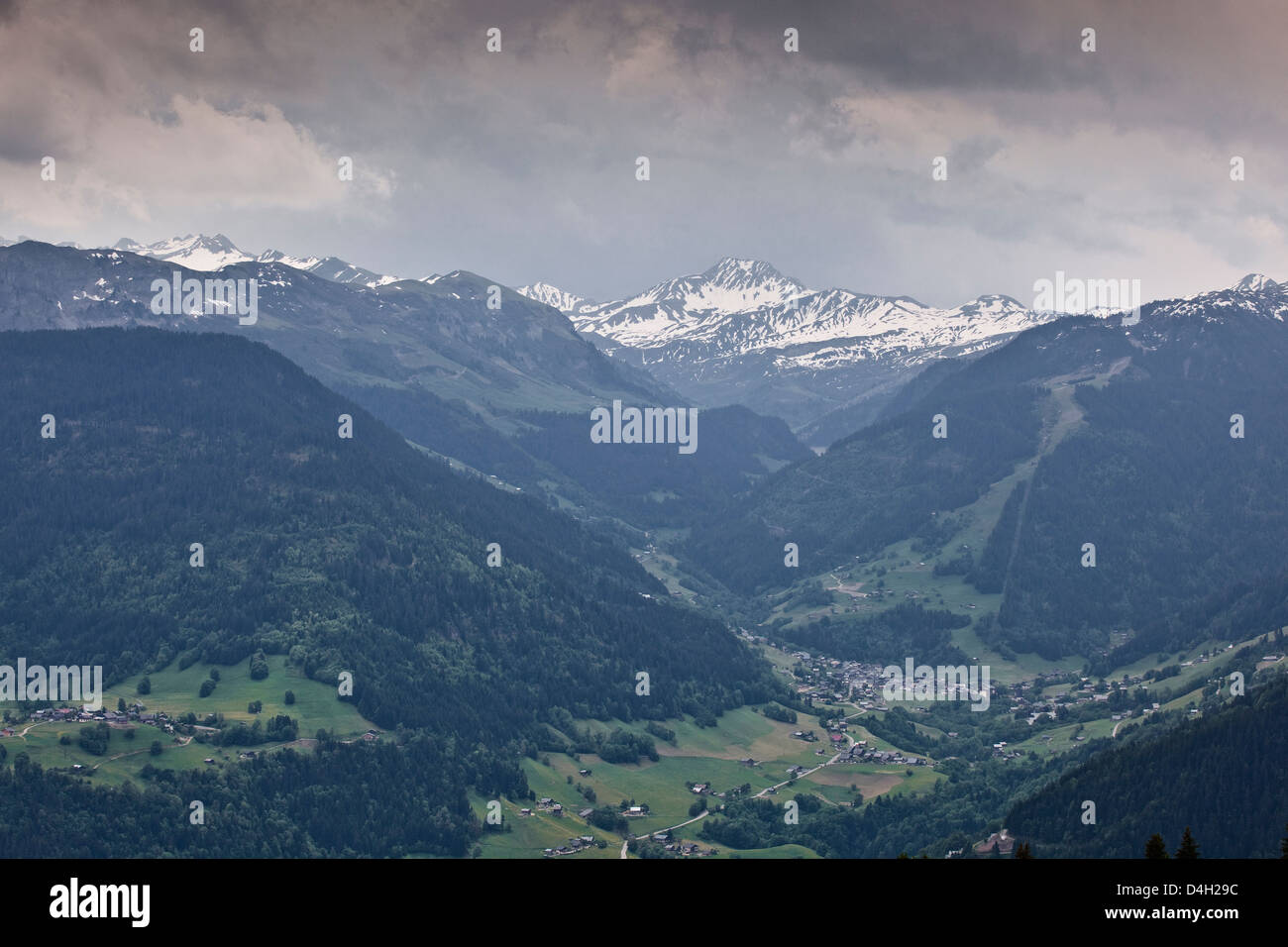 The snow capped mountains of the Haute-Savoie near to Les Saisies, Haute-Savoie, France - Stock Image