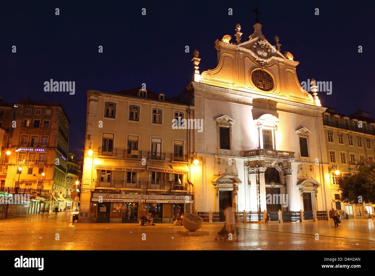 The Baroque style Leitaria Sao Domingos church, illuminated at night, in the Baixa district, Lisbon, Portugal - Stock Image