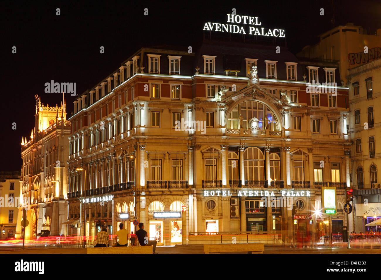The Hotel Avenida Palace, at night, on the Avenida de Liberdade, at Restauradores Square, Baixa, Lisbon, Portugal - Stock Image