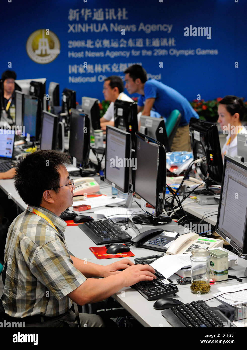 d68f776d1512 Journalists of Chinese news agency  Xinhua  work at the Main Press Centre  of the Olympic Games in Beijing