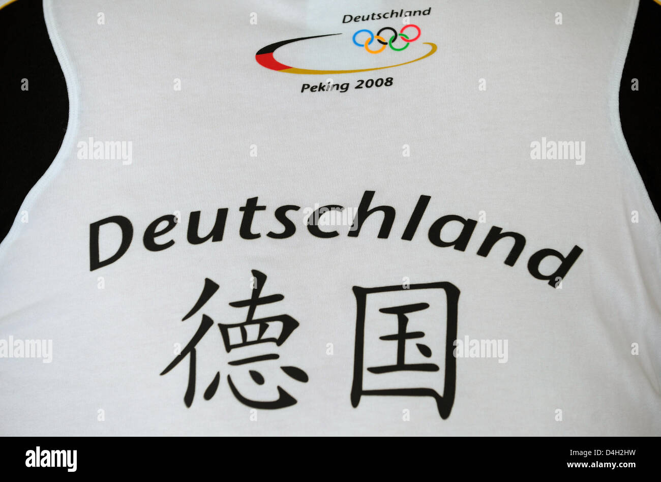 The writing 'Deutschland' (Germany) written in Latin letters and Chinese ideographs seen on the trikot of - Stock Image