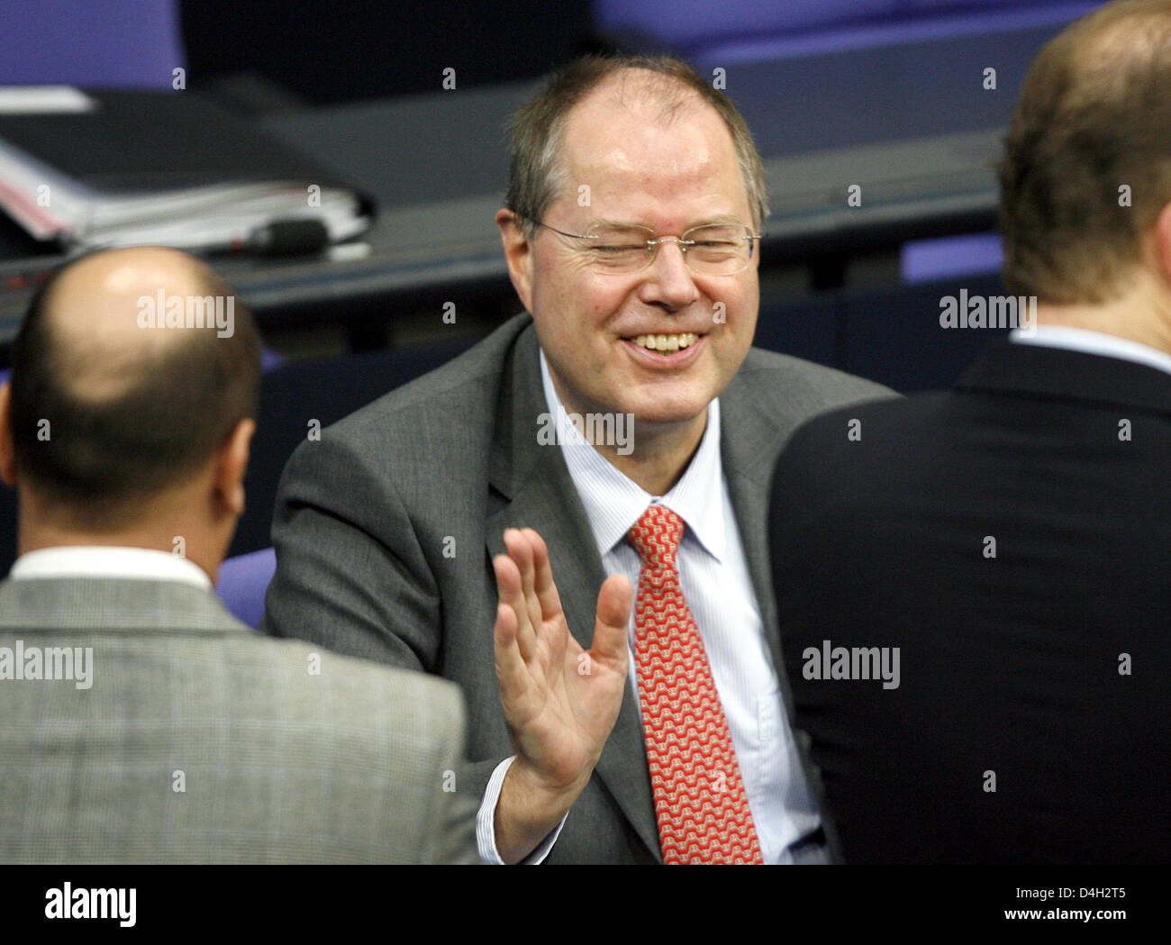 German Minister of Finance Peer Steinbrueck smiles prior to the debate on the global financial crisis at the Bundestag - Stock Image