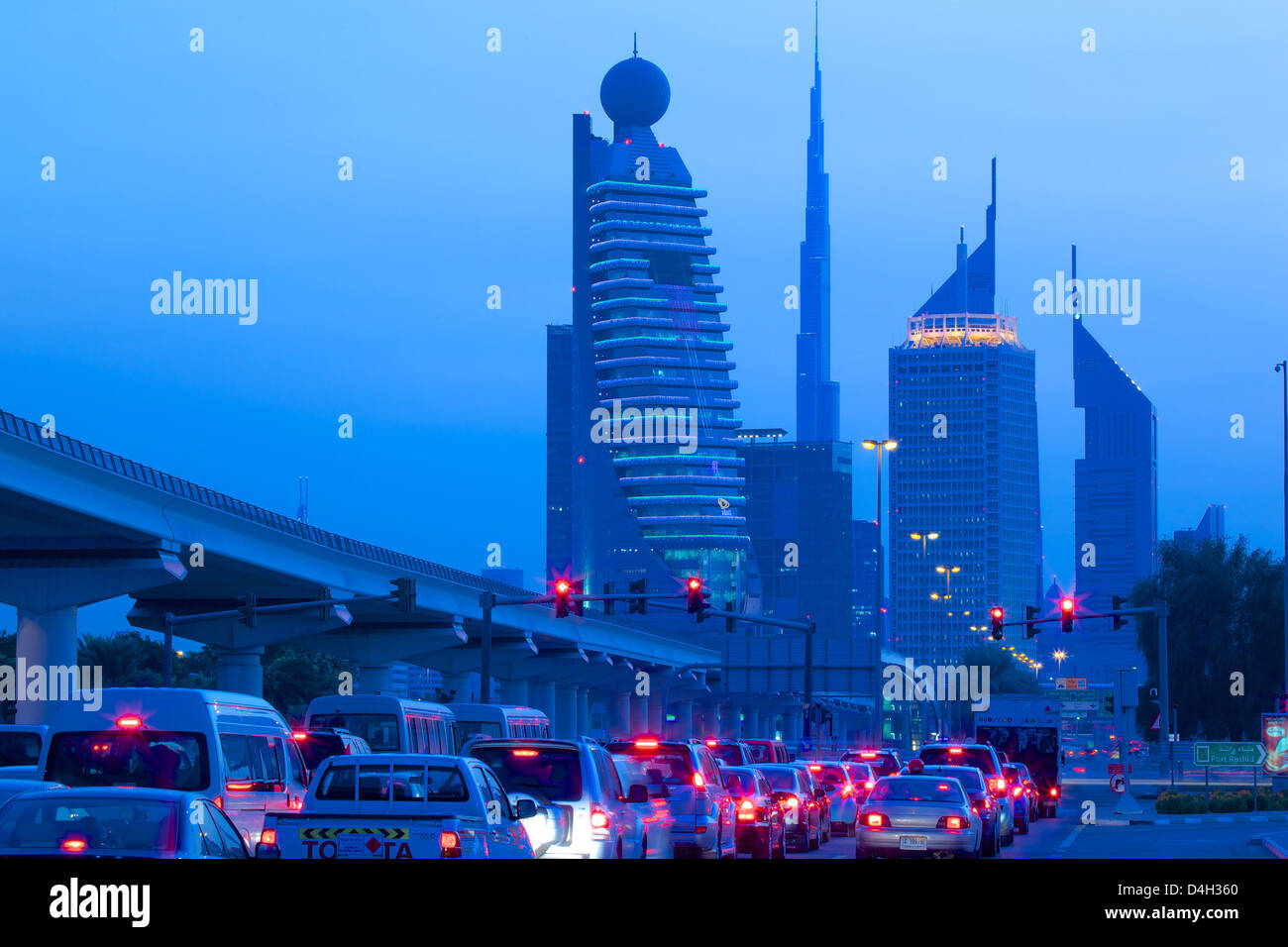 City skyline and car tail lights, Dubai, United Arab Emirates, Middle East - Stock Image