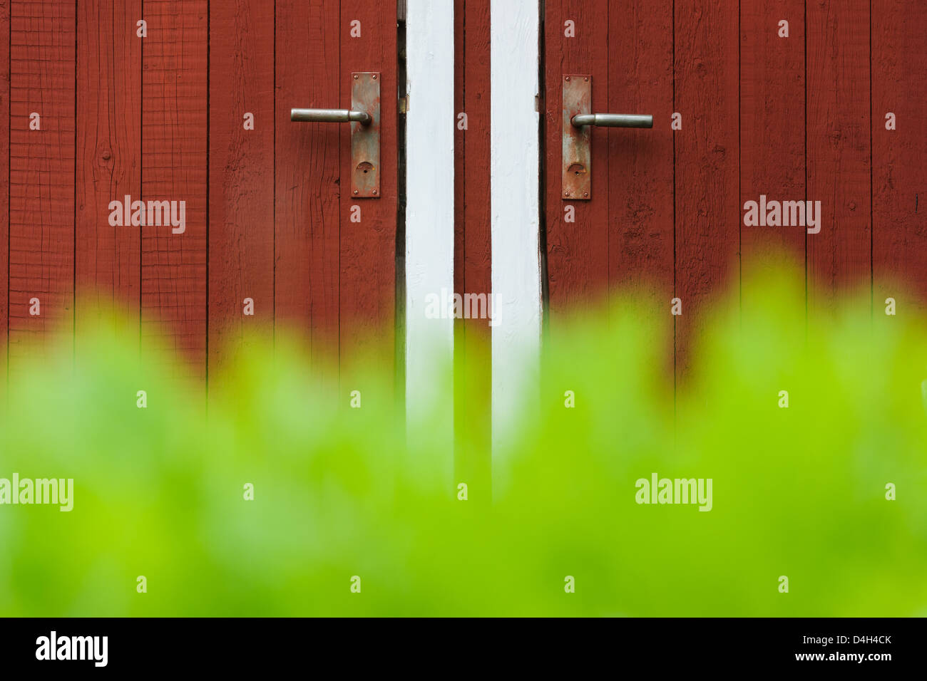 Closed farmhouse doors, Åtvidaberg, Östergötland, Sweden, Europe - Stock Image