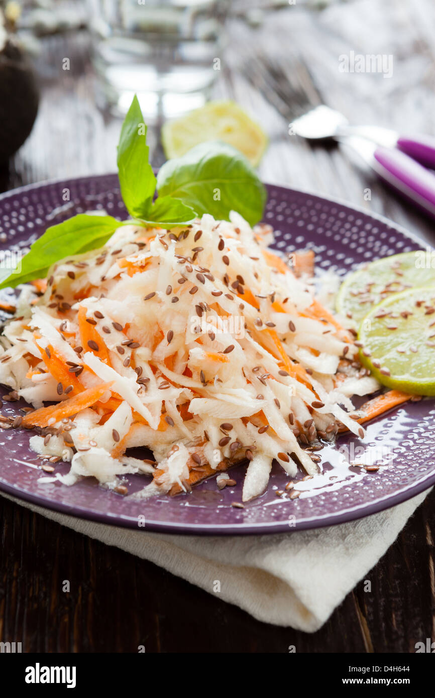 winter salad with black radish and carrots with lemon-honey filling - Stock Image