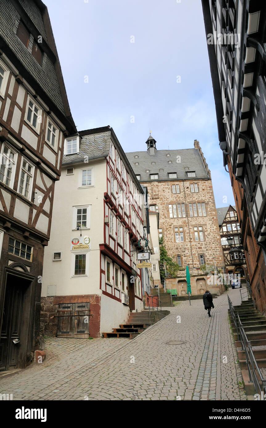 Steep narrow street in medieval city of Marburg, Hesse, Germany - Stock Image