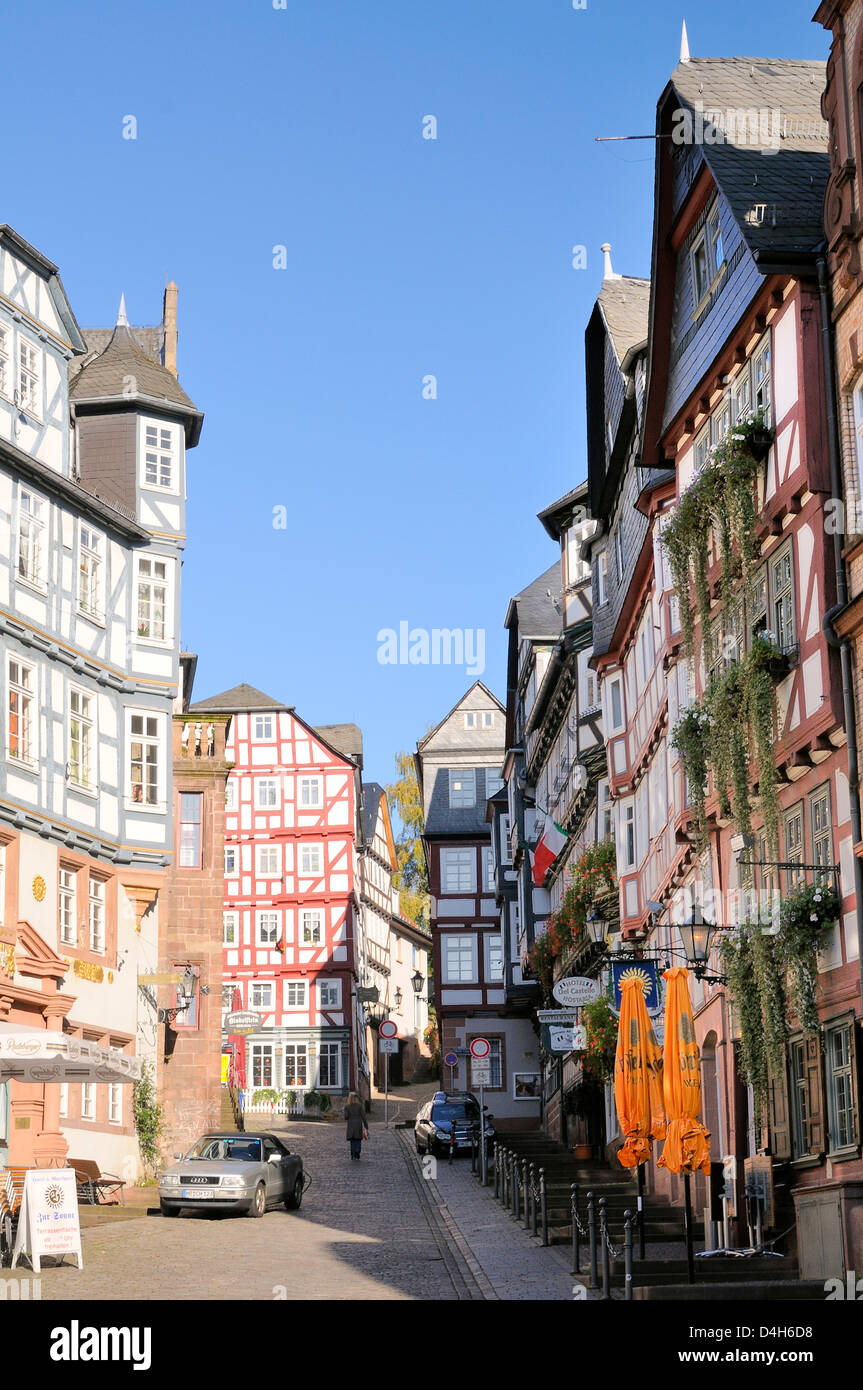 Medieval buildings on Mainzer street viewed from the Market square, Marburg, Hesse, Germany - Stock Image