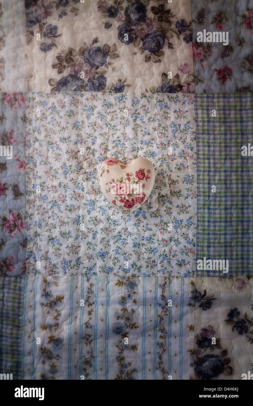 a heart with roses on a vintage plaid - Stock Image
