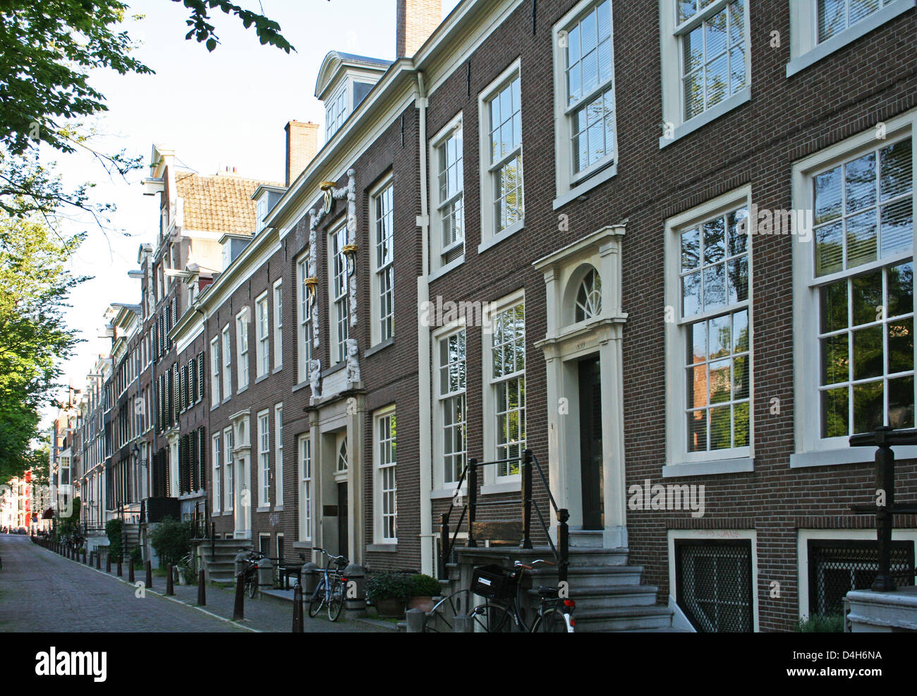 The Netherlands Holland Amsterdam Prinsengracht 855-899 Hofje 1695 Canal District Cornice - Stock Image