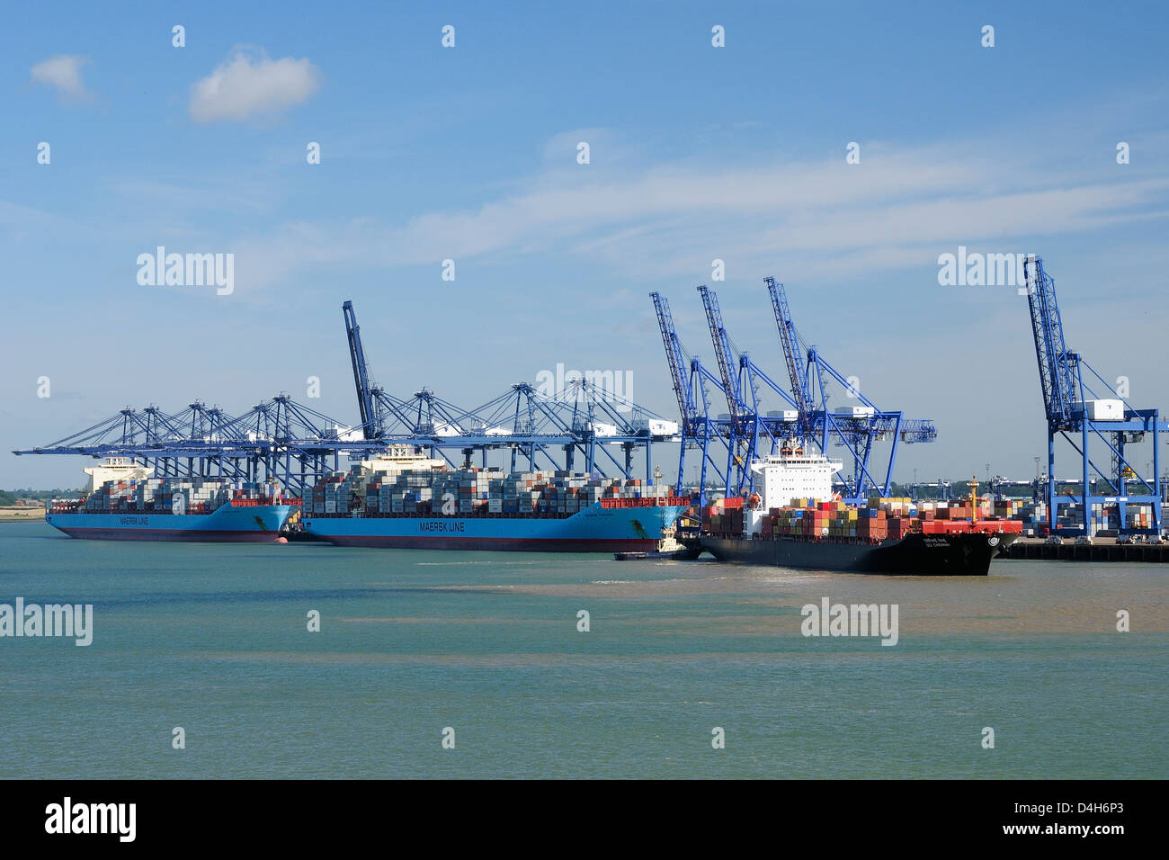 Container ships and loading derricks at Felixstowe Docks, Suffolk, England, UK - Stock Image