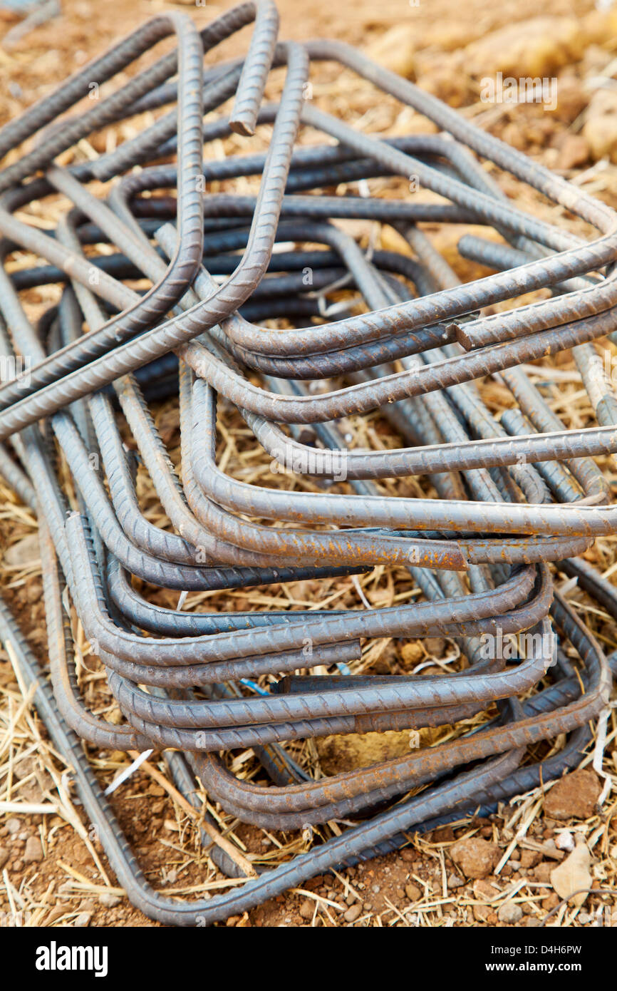 wrought iron rods used in the construction industry as concreting strengthening ties. Generic shot taken in Maharashtra, Stock Photo