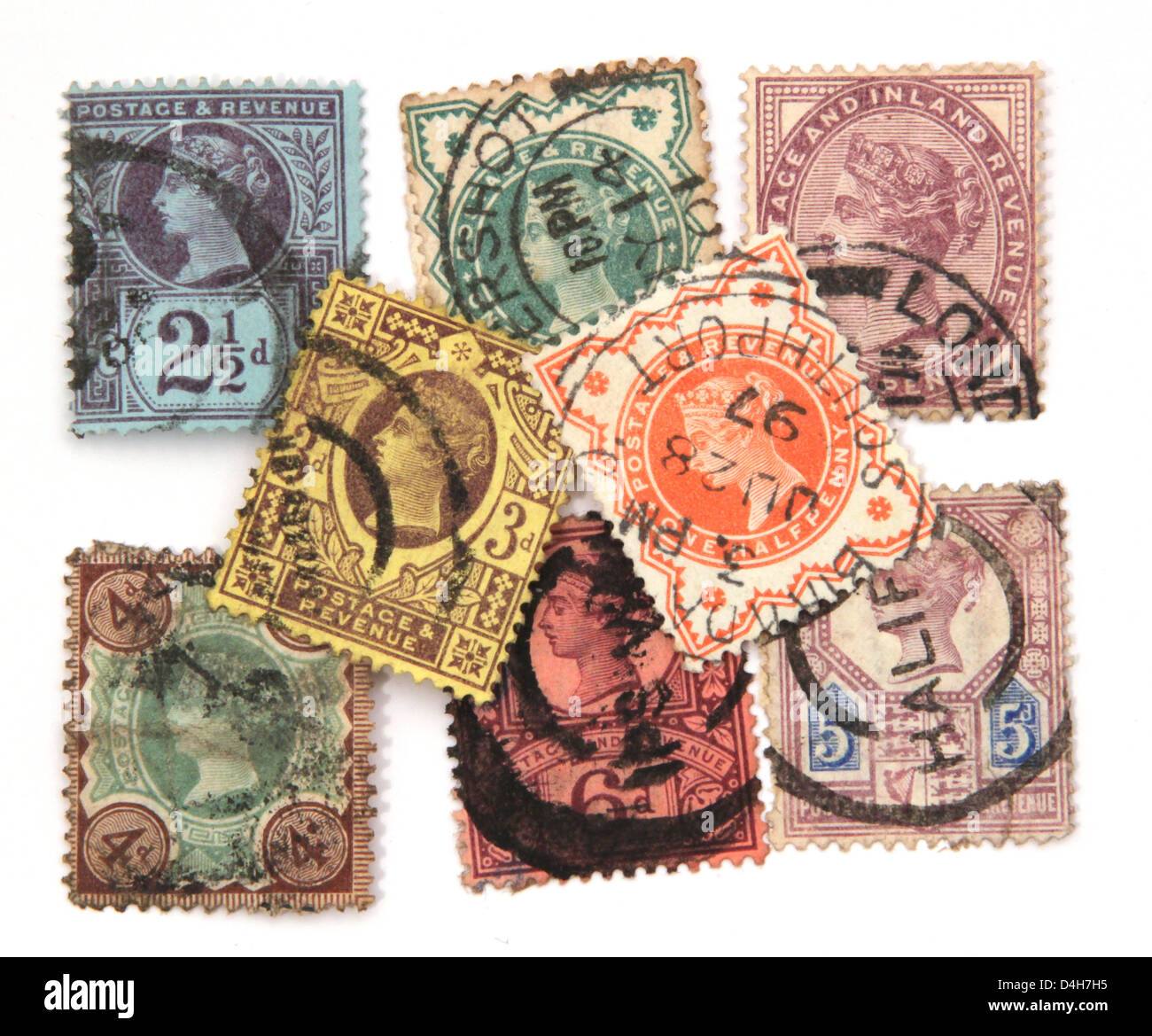 Assorted Victorian postage stamps on a white background. - Stock Image