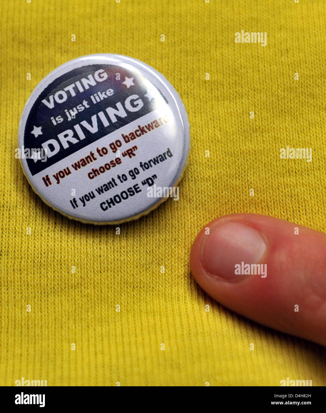 Student Stefanie Brendecke points at her election-button during a US election party at the canteen of the university - Stock Image