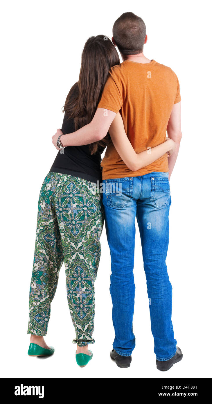 young couple man and woman are hugging and looking ahead back