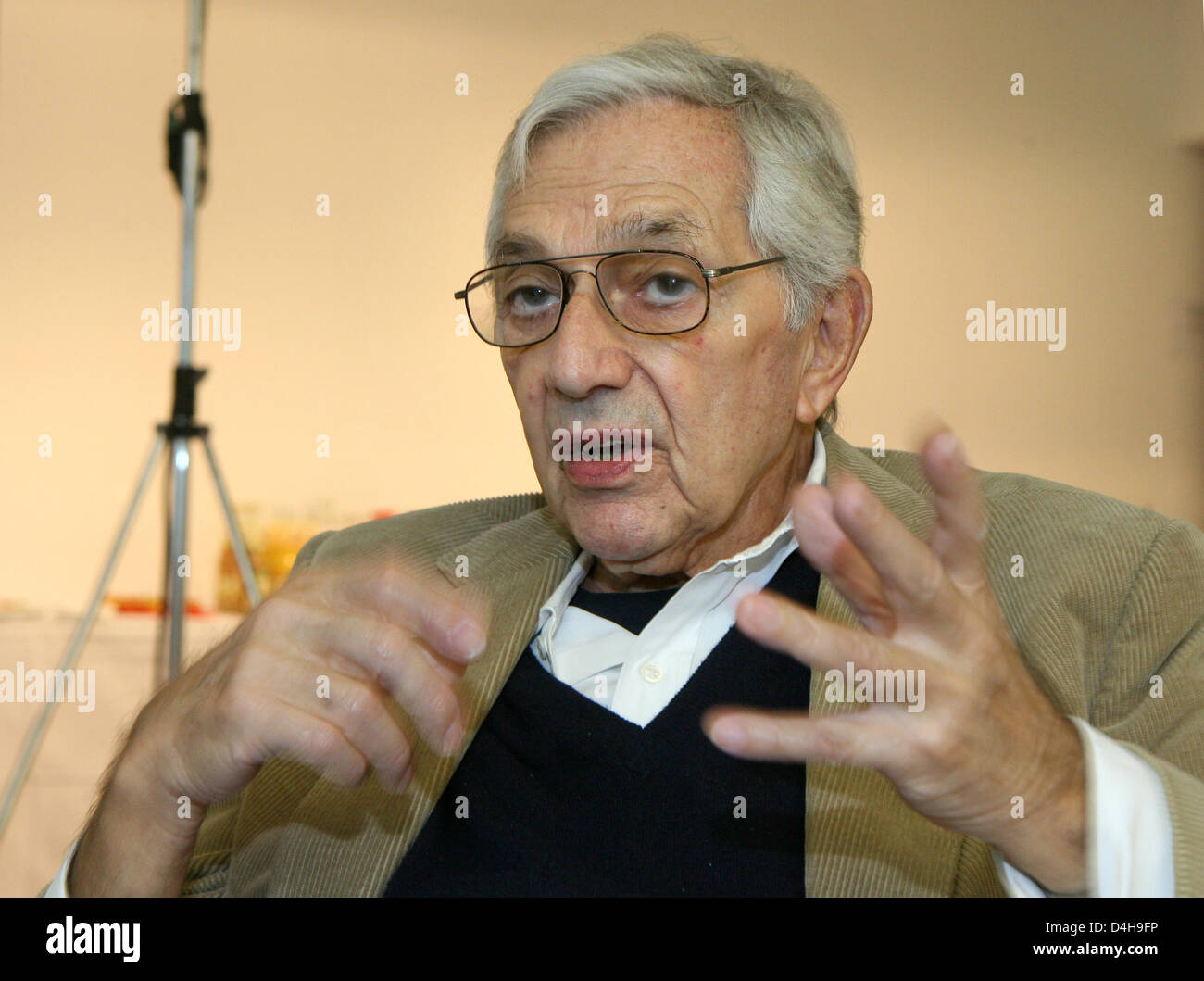 British production designer Ken Adam gestures during an interview ahead of a press conference in Berlin, Germany, - Stock Image