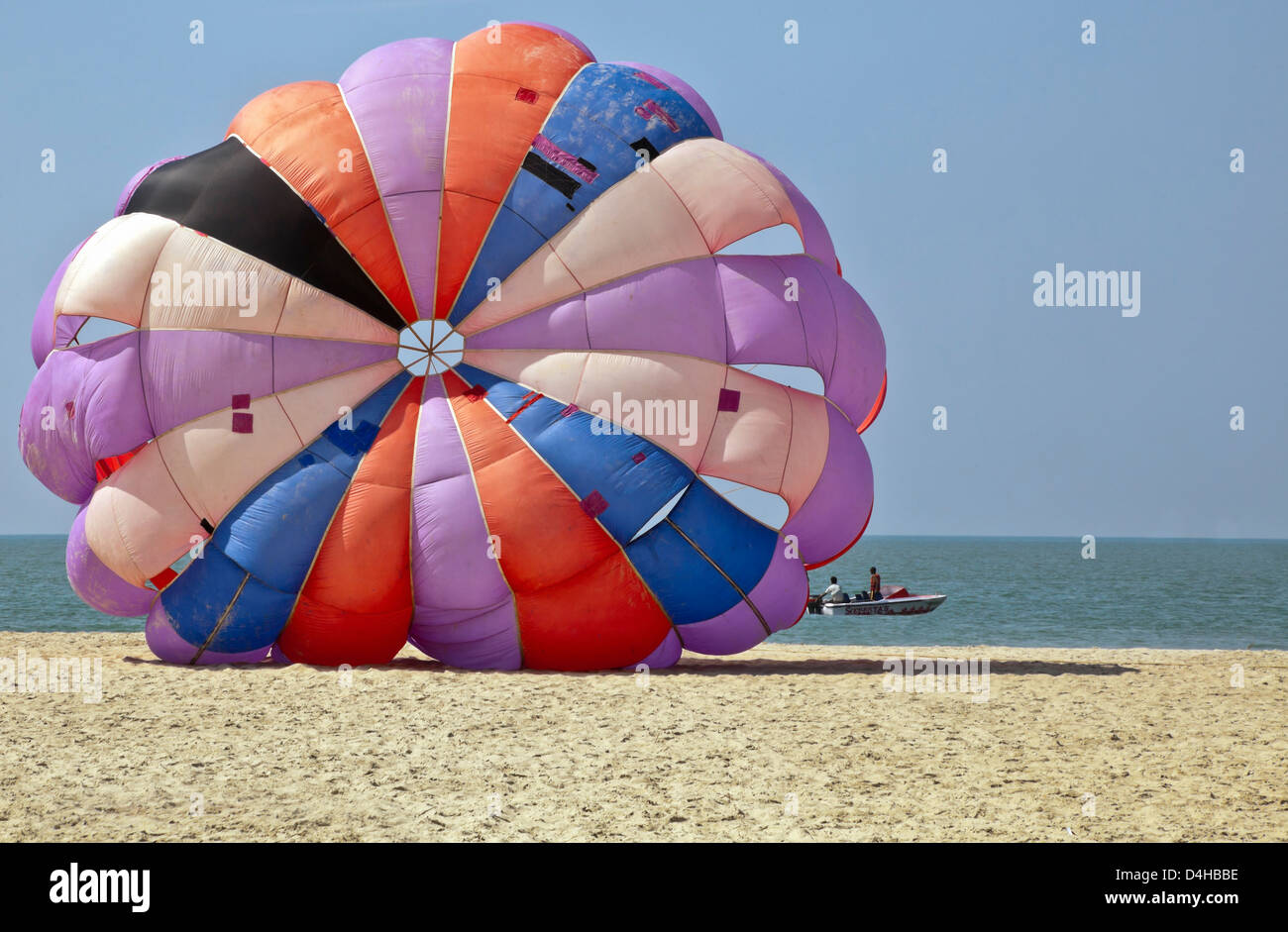 generic tropical shot of paragliders about to take flight over the ocean and beach area of Goa India Stock Photo