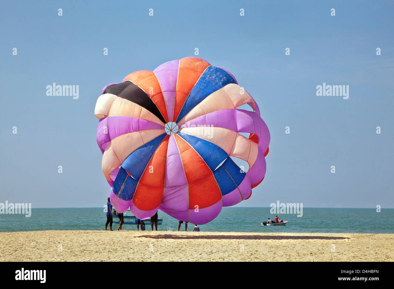 coastal ocean landscape, generic tropical of paragliders about to take flight over the ocean and beach area of Goa Stock Photo