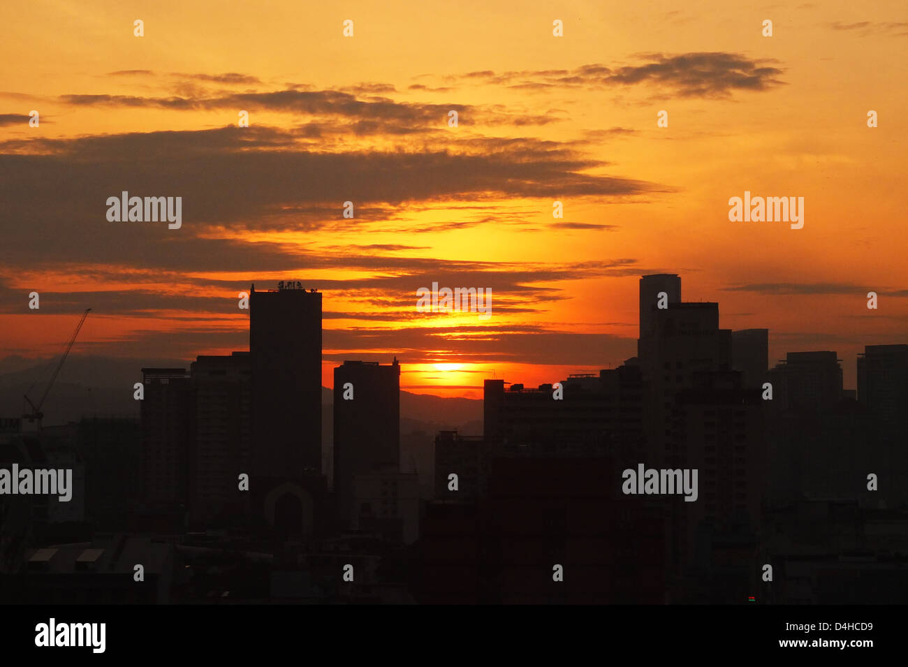 A morning sun is coming from behind building, great sky colour,city awaiting to be wake up - Stock Image
