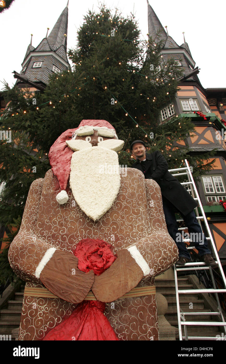 The according to its creator Gerhard Petzl world?s biggest chocolate Santa Claus is presented in Wernigerode, Germany, - Stock Image