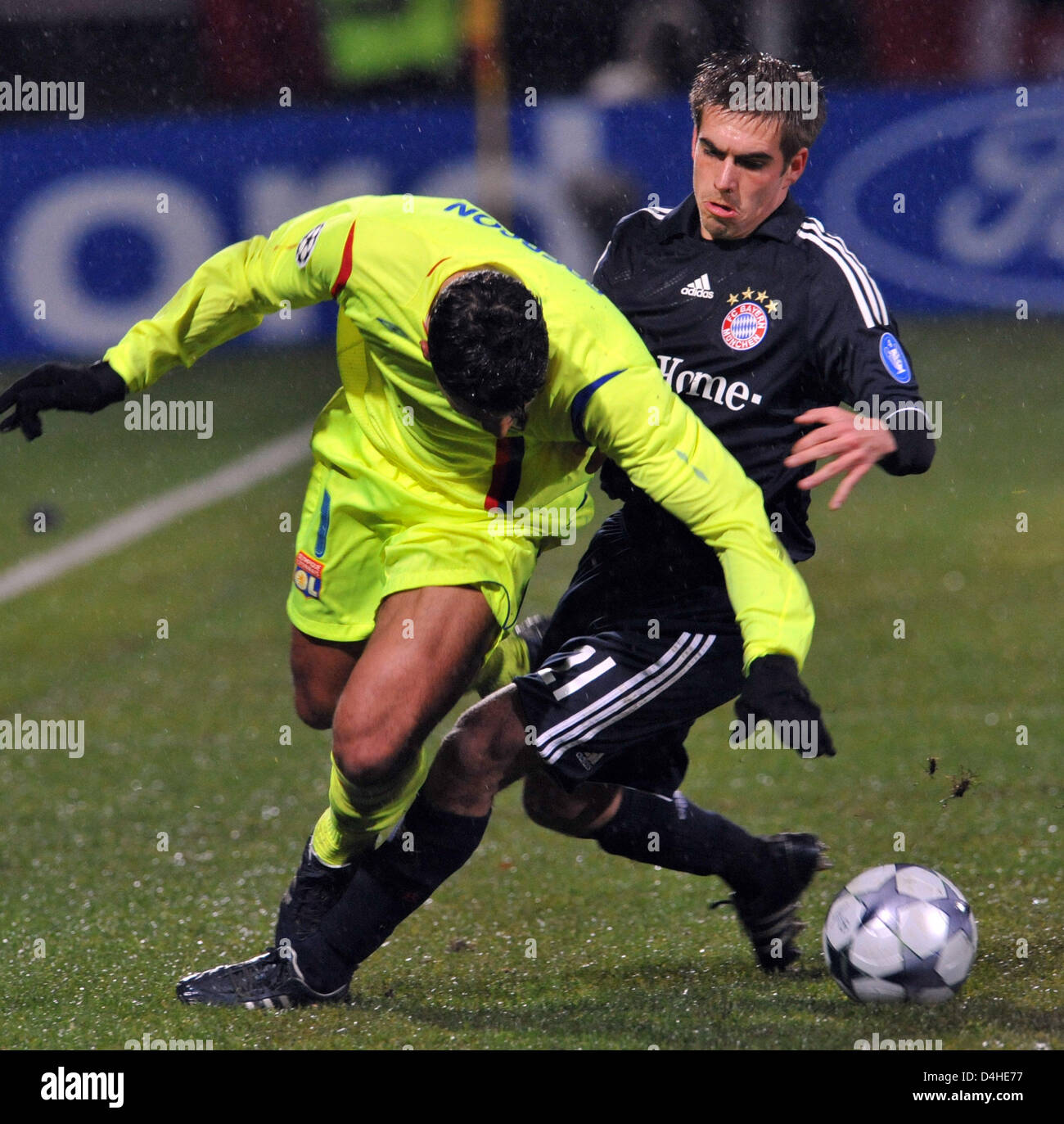 Ederson of Olympique Lyon vies for the ball with Philipp Lahm of FC Bayern Munich during the Champions League Group Stock Photo