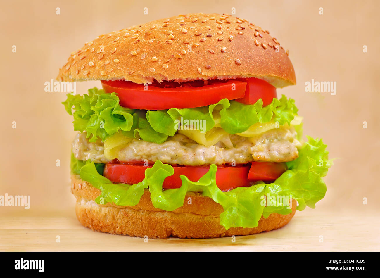 Burger fast food on a wooden table - Stock Image