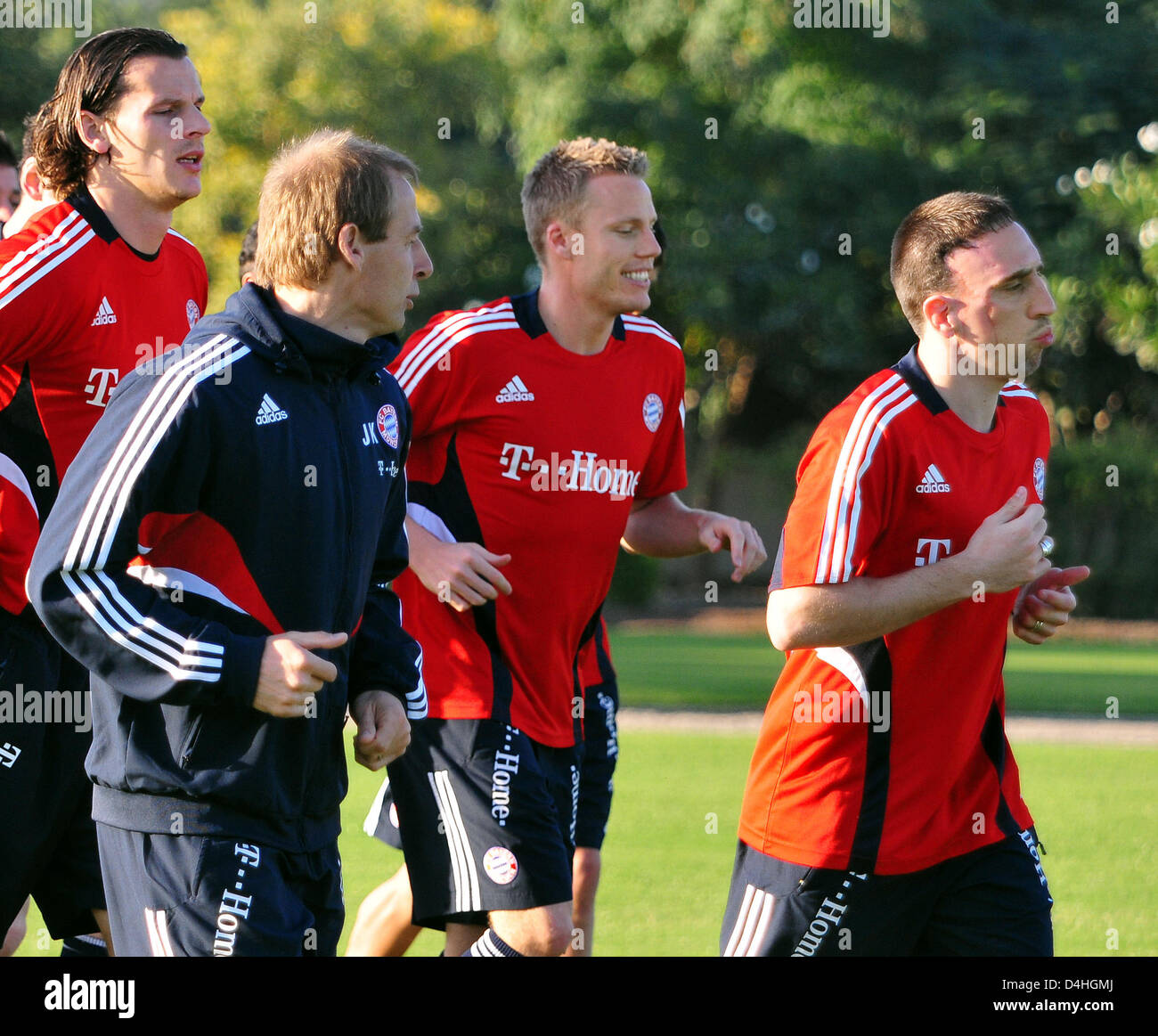 Daniel van Buyten (L-R), coach Juergen Klinsmann, Christian Lell and Franck Ribery of German Bundesliga soccer club Stock Photo