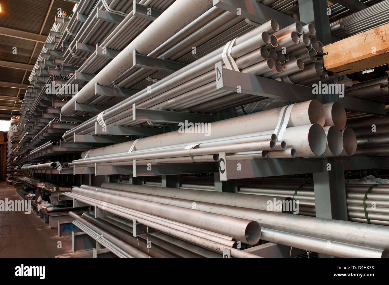 Steel tubes stacked in a warehouse at a steel stock holders in the West Midlands, UK Stock Photo