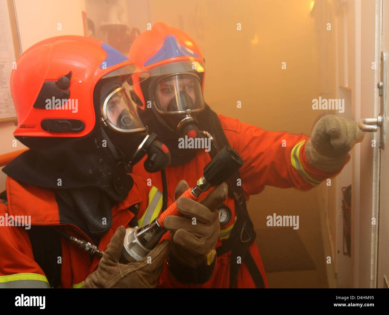 Danish navy soldiers practice fire emergency measures onboard fregate ?Thetis? off the coast of Neustadt, Germany, - Stock Image