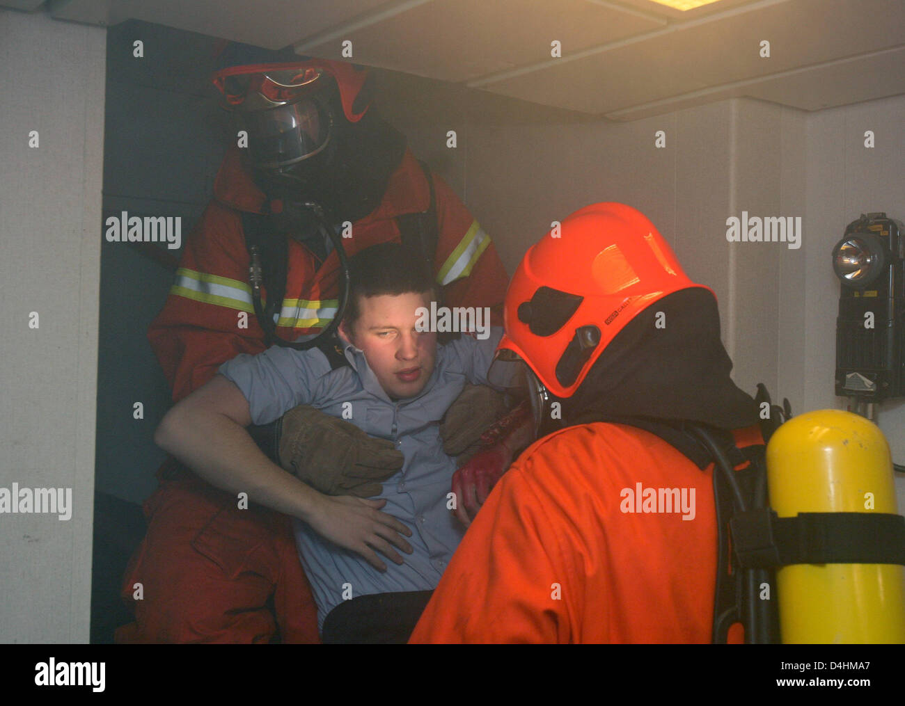 Danish navy soldiers practice fire emergency measures onboard fregate ?Thetis? off the coast of Neustadt, Germany, Stock Photo