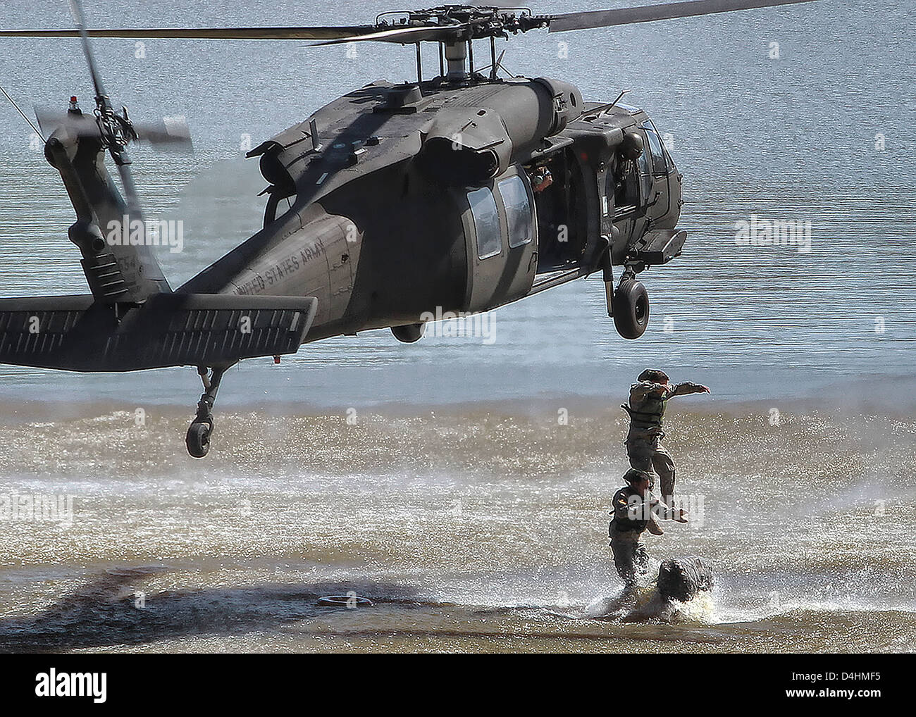 US Army Rangers leap into the water from a Black Hawk helicopter during training April 16, 2011 in Fort Benning, - Stock Image